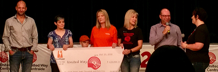Employees presenting United Way cheque